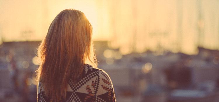 Blong-Girl-Thoughfully-Watching-A-Sunrise