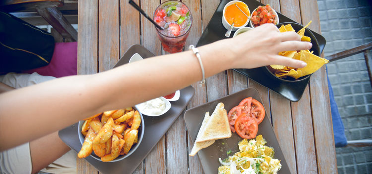 Girls-Hand-Reaching-accross-Mexican-Tapas-Cafe-Table