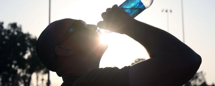 man_rehydrates_drink_water